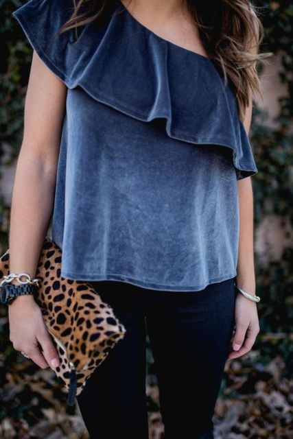 With velvet blouse and navy blue pants