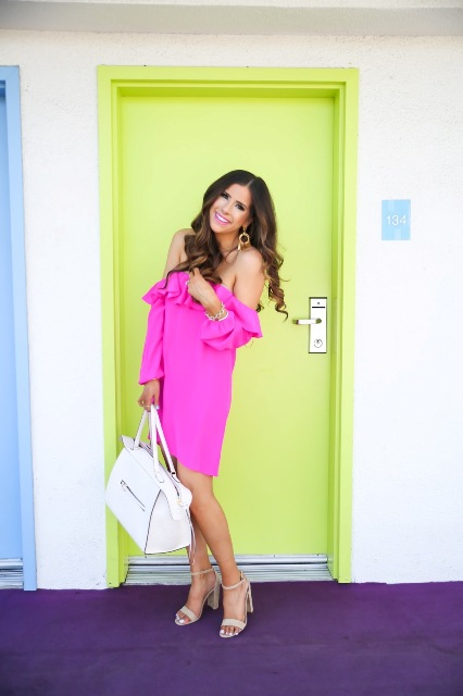 With white big bag and white heels