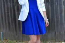 With white blazer, statement necklace and beige shoes