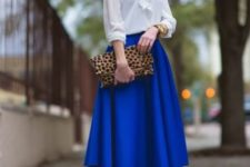 With white blouse, leopard clutch and metallic sandals