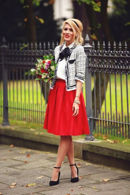 With white blouse, printed jacket and black shoes
