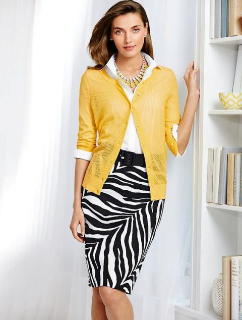 With white blouse, yellow cardigan and black belt
