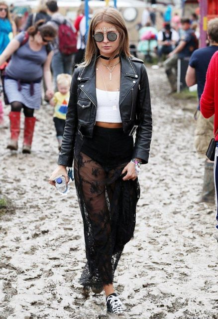 With white crop top, black leather jacket and sneakers