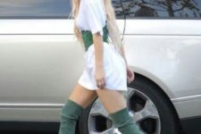 With white long t-shirt and over the knee boots