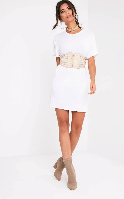With white mini dress and neutral color boots