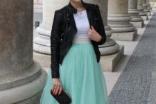 With white shirt, black jacket, black clutch and shoes