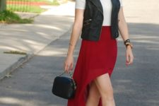 With white shirt, black vest, black cutout boots and small bag