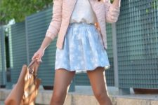With white shirt, blue mini skirt and brown tote