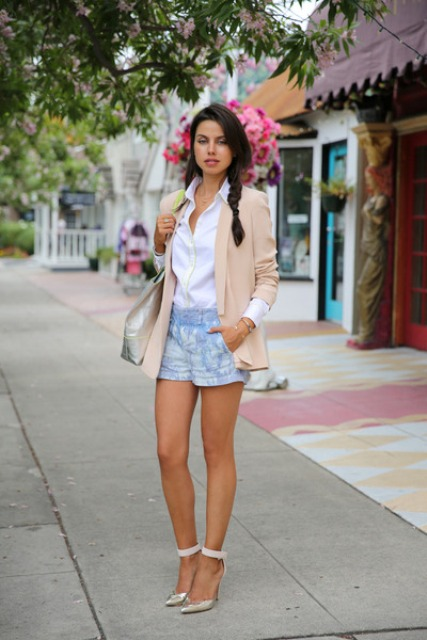 With white shirt, blue shorts, metallic shoes and tote