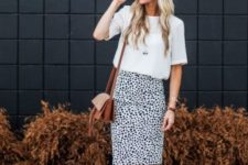 With white shirt, brown bag and lace up sandals
