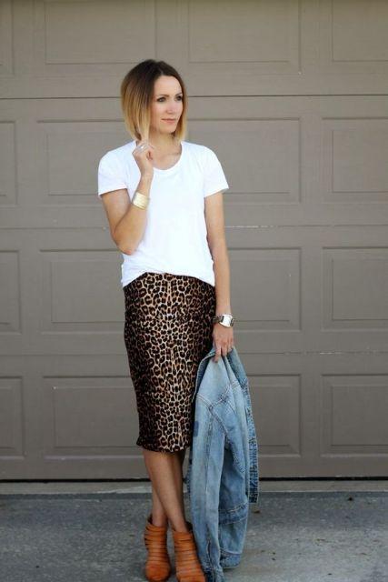 With white shirt, denim jacket and orange shoes