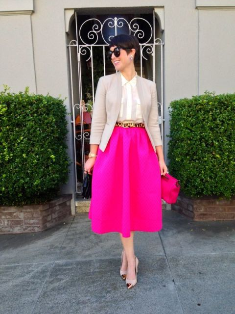 With white shirt, light gray jacket, leopard belt and two color shoes