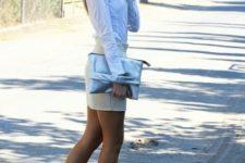 With white shirt, mini beige skirt and metallic clutch