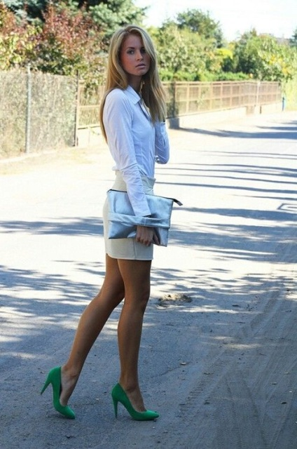 With white shirt, mini beige skirt and metallic clutch