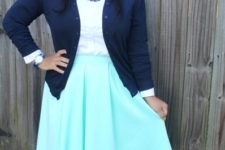 With white shirt, navy blue cardigan and gray boots