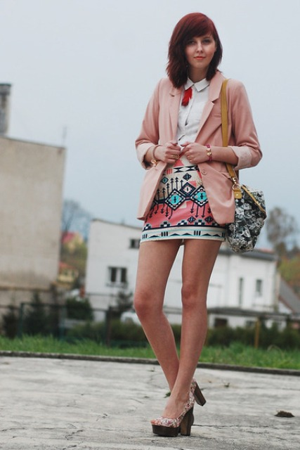 With white shirt, printed mini skirt and sandals