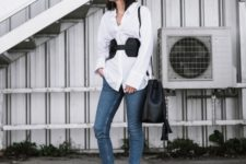 With white shirt, skinny jeans, printed shoes and black leather bag