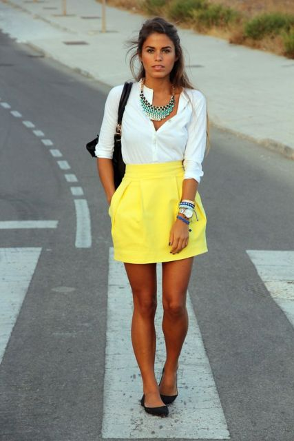 With white shirt, statement necklace, black flats and black bag