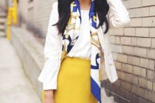 With white shirt, white jacket, camel bag and printed scarf