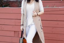With white shirt, white skinny pants, camel long vest and printed bag