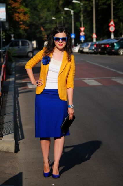 With white shirt, yellow blazer and blue shoes