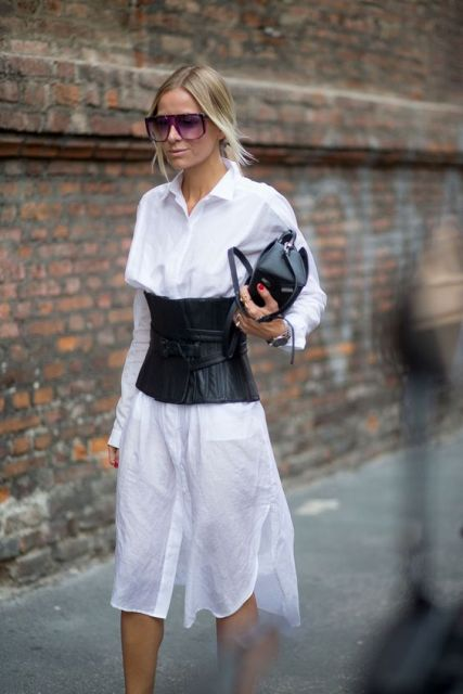 With white shirtdress and black small bag