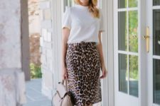 With white t-shirt, beige bag and neutral color shoes