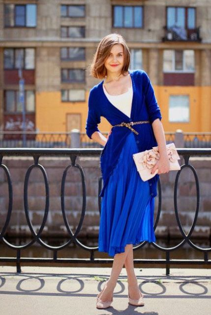 With white t-shirt, cobalt blue cardigan, pale pink clutch and shoes