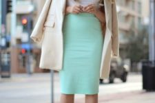 With white top, platform shoes and beige coat