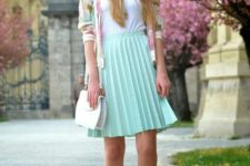 With white top, sneakers, pastel color jacket and white bag
