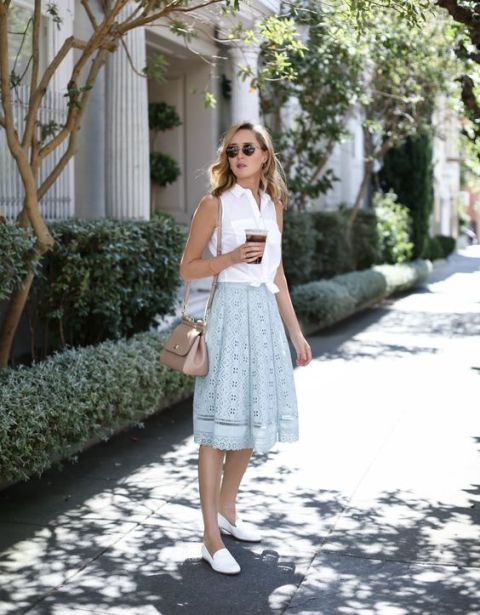 With white top, white loafers and beige bag
