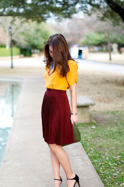Spring skirt outfit with yellow blouse and black heels