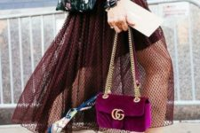 With yellow heels and velvet chain strap bag