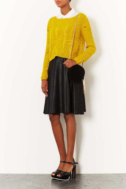 With yellow loose shirt, black skirt and black sandals