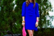 With yellow sandals and pink clutch