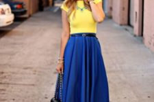 With yellow shirt, lace up shoes and chain strap bag