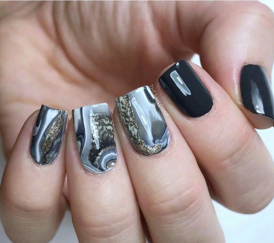 black and agate-inspired grey and white nails