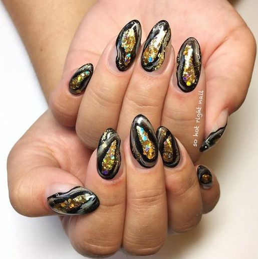 bold geode nails in black and gold glitter