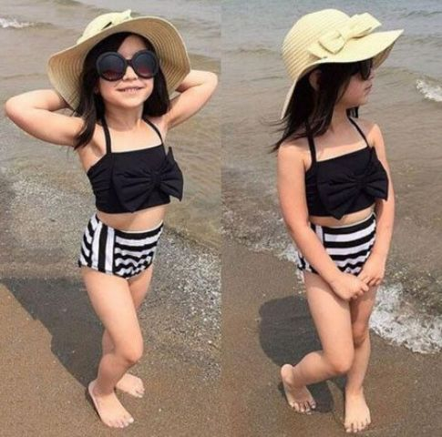 a black bow top and high waist striped shorts look timeless and chic