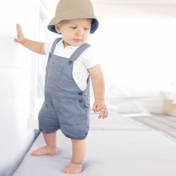 a white polo shirt and a blue gingham overall is comfy for little boys