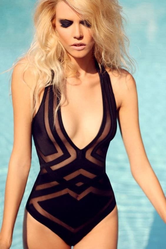 black strap one-piece swimsuit with geo prints and a plunging neckline