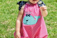03 a pink polka dot romper with a whale applique and bows