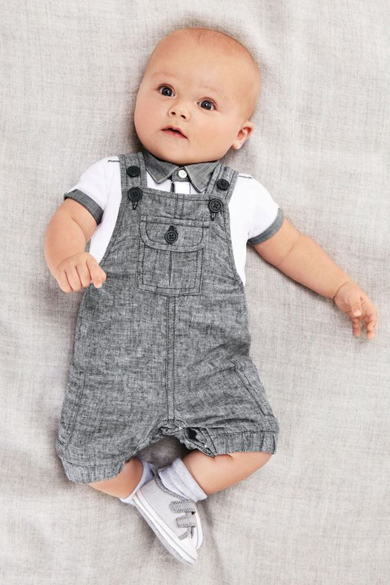 a white polo with grey details and a matching overall for a small boy