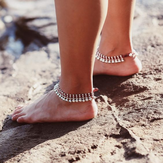 layered anklets of pearls and silver beads