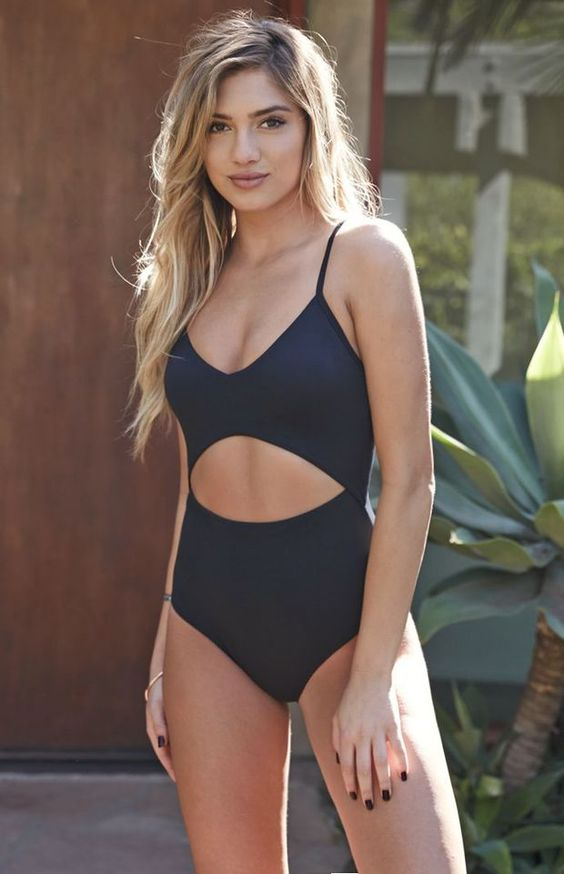 navy spaghetti strap one piece swimsuit with a drop-shaped cutout on the front