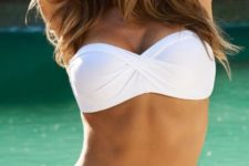 03 white draped bandeau top and a matching white bottom with a geometric print