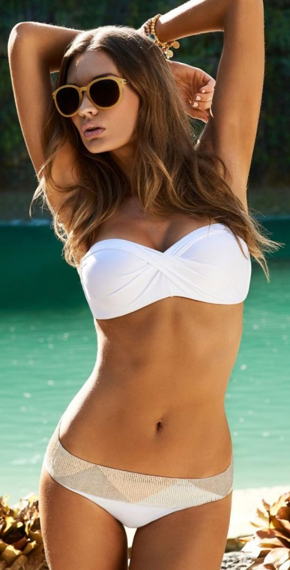 white draped bandeau top and a matching white bottom with a geometric print