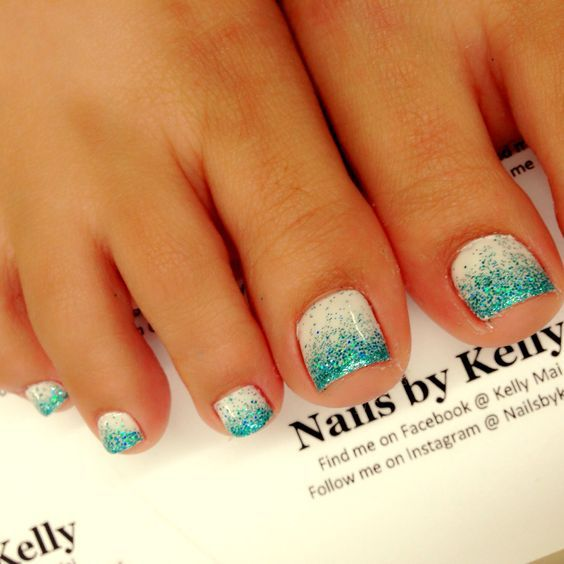 white nails with turquoise glitter is a simple and cute idea