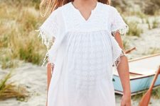 04 a cotton cover-up with fringe that can also double as a lightweight everyday layer