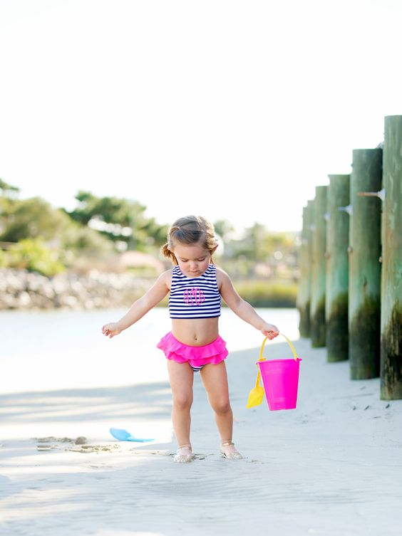 a striped top and bottom with pink ruffles